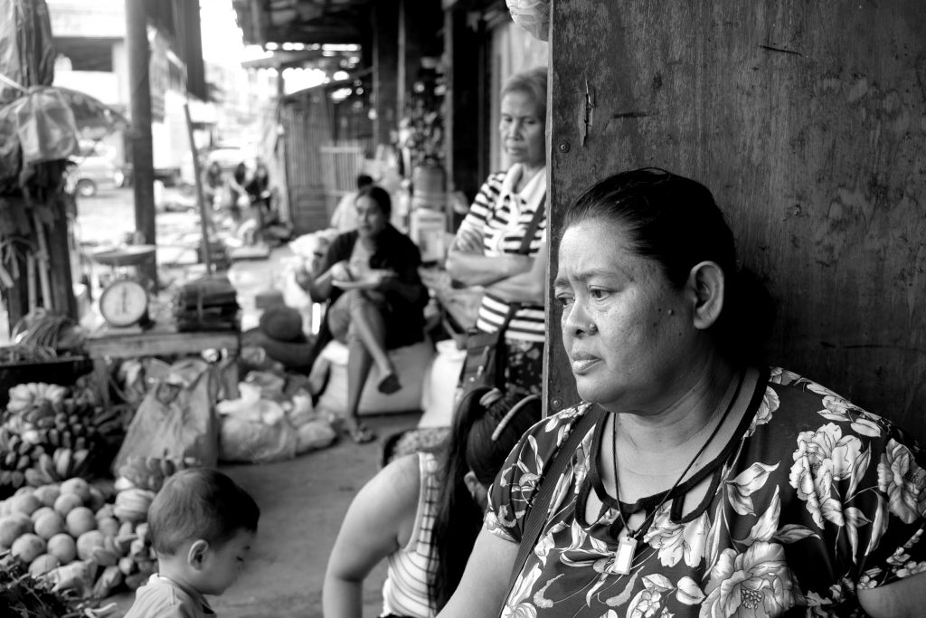THE OTHER SIDE. The streets may have been cleared but Elizabeth Villacampa is confused as to where to get the next meal as her street vending had been affected. |Photo by Lourdes Rae Antenor, text by Julius D. Mariveles