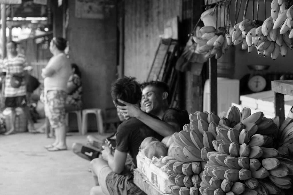 BANANA vendors at the North Public Market share a light moment as they watch over the produce they sell. These vendors are among those who rent regular stalls within the market unlike the illegal vendors who hawk on the surrounding streets.|Photo by Lourdes Rae Antenor, text by Julius D. Mariveles