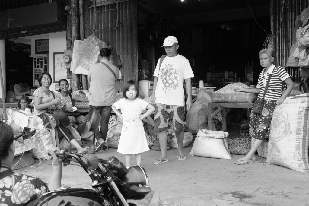 JUST DARE. A young daughter of a market vendor owning this stall along Amelia Avenue at the South or Libertad Public Market makes a defiant gesture at the photographer. This child has seen the demolition of illegal structure for days at Amelia. |Photo by Lourdes Rae Antenor, text by Julius D. Mariveles