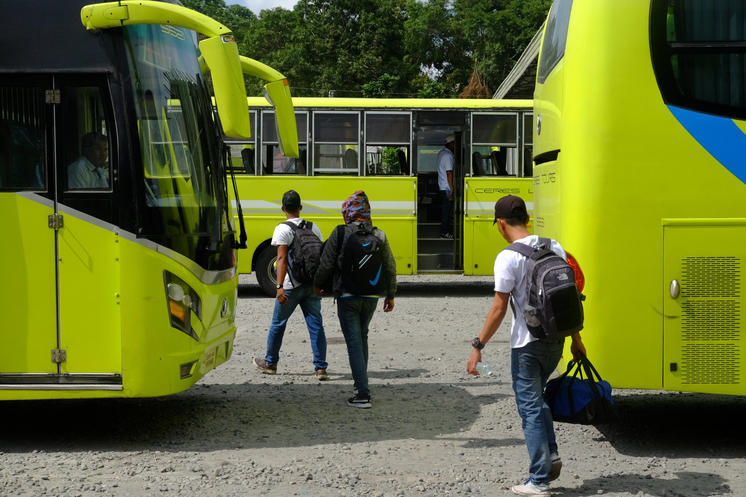 Passengers make their way to parked buses of the Ceres Liner at the southern terminal in Bacolod City.   Photo by Jose Aaron C. Abinosa