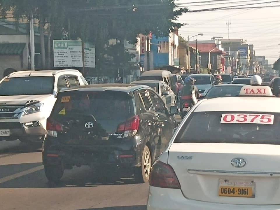 Private vehicles create traffic along Lacson-Burgos Streets. Since the untat-biyahe covers only public transport, privately-owned cars and taxi cabs continue plying the city streets, so certain thoroughfares are still as busy as ever. | Photo by Hannah A. Papasin