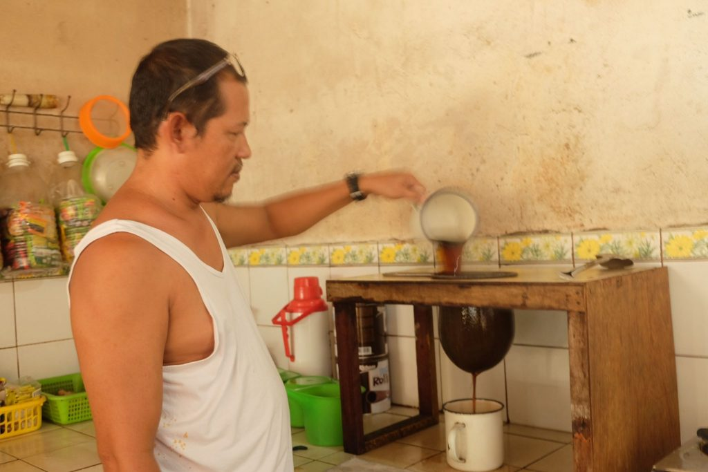"""FRESHLY BREWED. Santiago """"Bobot"""" Mahilum brews a fresh batch of native coffee in the kitchen of KD's Cafe, a local coffeeshop he runs with his wife. 