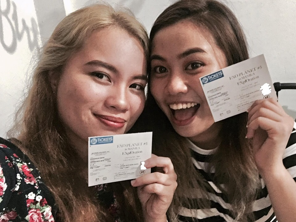 Evan and Ems showing their Exo concert Tickets. | Photo by Evan Jane Guino-o
