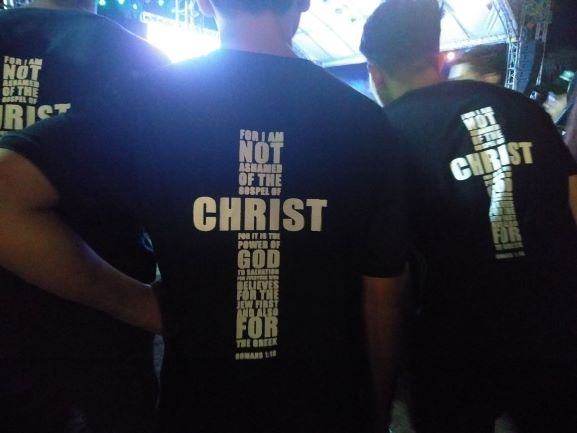 Declaration of faith. Shirts with a bible verse printed on it are being worn by the youth members. Photo by Elian Quilisadio
