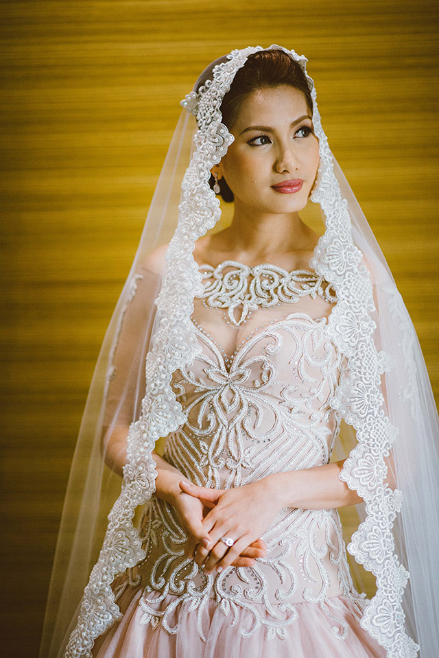 Jun's designs highlight everything associated with femininity: beadwork, figure-flattering silhouettes, and details like laces and embroidery.  Photo courtesy of Junriz Henderin