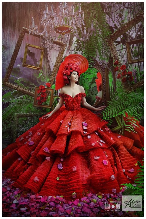 RED = Passion.  The tiered-skirt, the voluminous layers are enough to make a young girl feel like royalty -- if only for a day.  Photo furnished to DNX by the designer.