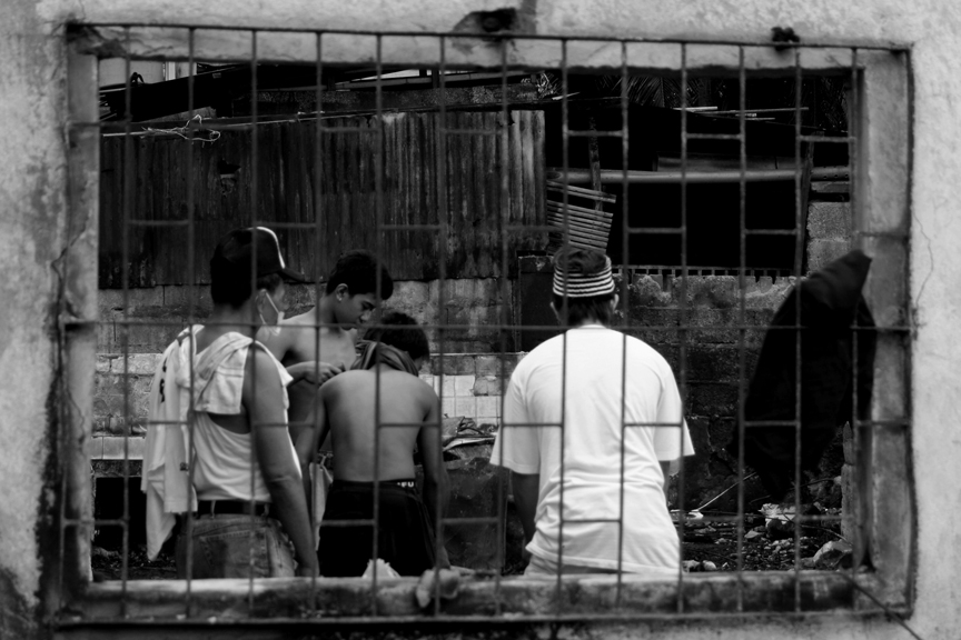 Survivors of the November 2, 2009 fire in Village 19, Bacolod City go through whatever remains of their belongings inside their gutted house. | Photo taken by Julius D. Mariveles originally appeared on his personal blog on November 2, 2011.