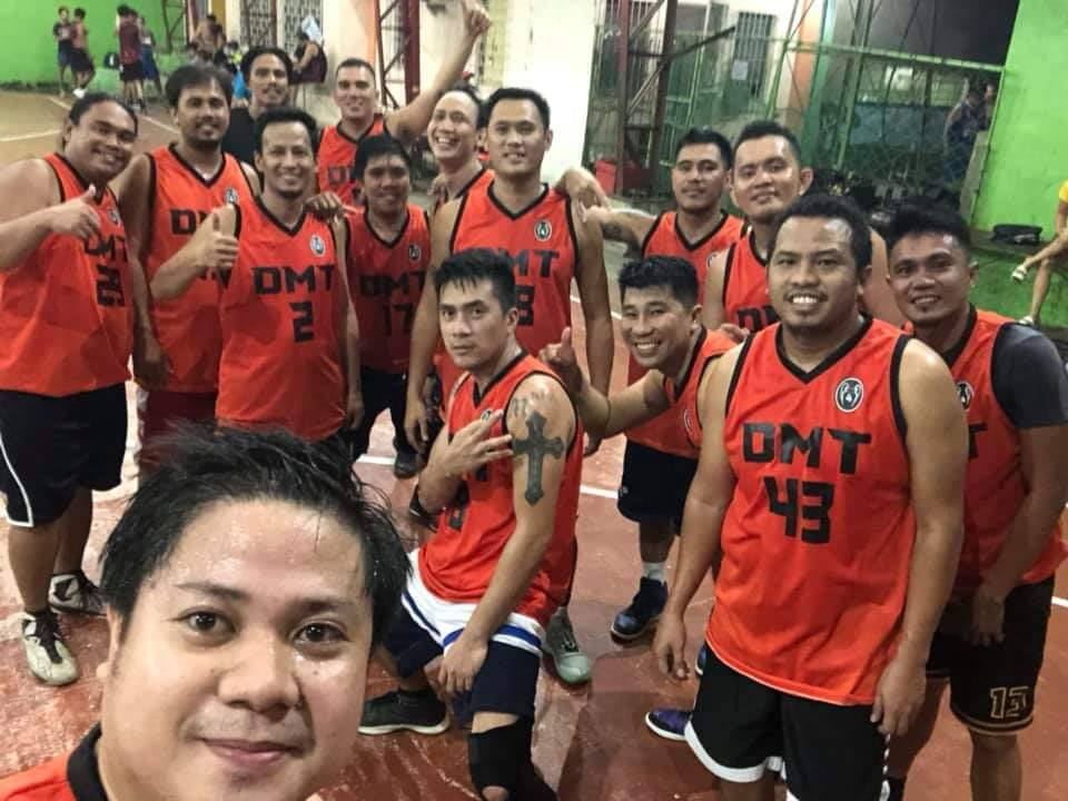 Rosinie with his high school bstch basketball team. | Photo courtesy of Rosinie Distrito
