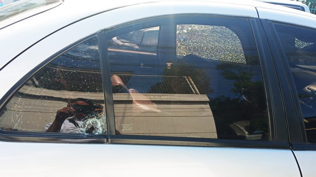 A lone bullet hole at the opposite side of the driver's sear indicates the possibility one of the killers of Kaishek Tan made sure he was dead by shooting from the opposite side while he was already sprawled inside the vehicle. | Photo by Richard D. Meriveles