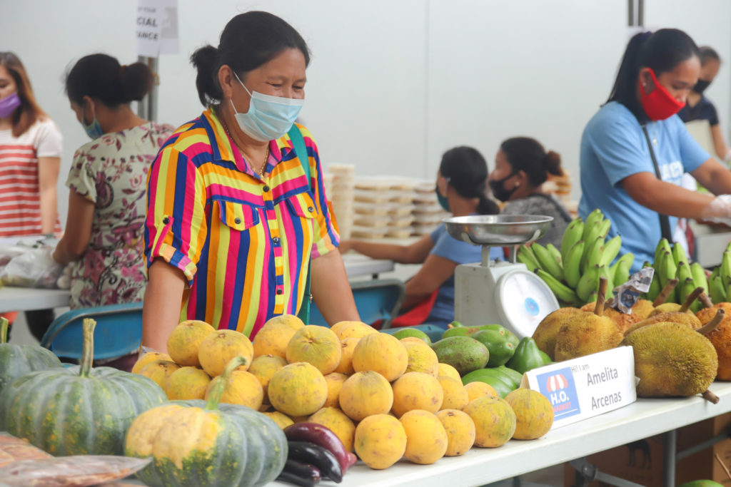 Amelita, a fruit vendor, offers a variety of produce at the H.O. Market. | Photo from NWTF