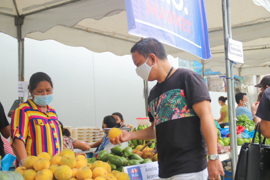 Jesus, NWTF staff, checks out fruit on display at the H.O. Market. | Photo by NWTF