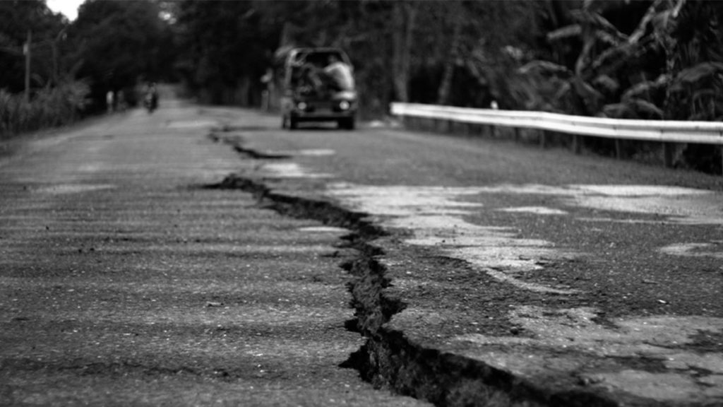 A YAWNING CRACK IN THE MIDDLE OF THIS ASPHALT ROAD can be seen in the village of Maluya in Guihulngan City, Oriental Negros, one of the affected areas during the 6.9 magnitude quake | Photo by Julius D. Mariveles