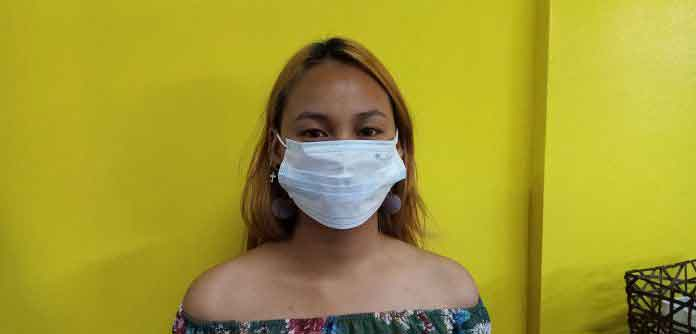 Not recommended way of how to wear a surgical mask. | Photo by Richard D. Meriveles
